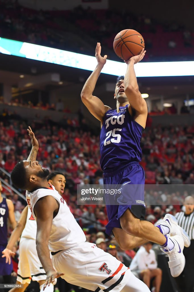 Alex Robinson #25 of the TCU Horned Frogs shoots the ball against Niem Stevenson #10 of the Texas Tech Red Raiders during the second half of the game on March 3, 2018 at United Supermarket Arena in Lubbock, Texas. Texas Tech defeated TCU
