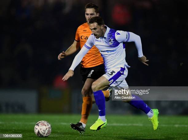 Alex Rodman of Bristol Rovers beats Charlee Adams of Barnet to the ball during the FA Cup First Round Replay match between Bristol Rovers and Barnet...
