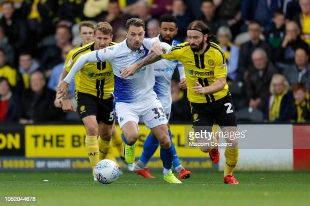 Alex Rodman of Bristol Rovers competes with John Brayford of Burton Albion during the Sky Bet League One match between Burton Albion and Bristol...