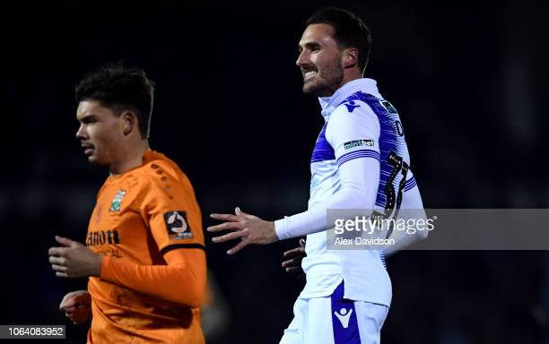 Alex Rodman of Bristol Rovers reacts to a chance as Craig Robson of Barnet looks on during the FA Cup First Round Replay match between Bristol Rovers...
