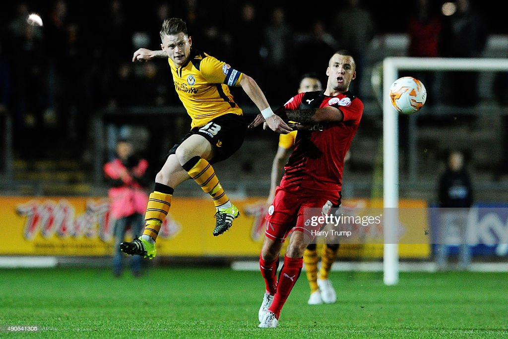 Alex Rodman of Newport County challenges for the high ball with Jimmy Smith of Crawley Town during the Sky Bet League Two match between Newport County and Crawley Town at Rodney Parade on September 29, 2015 in Newport, Wales.