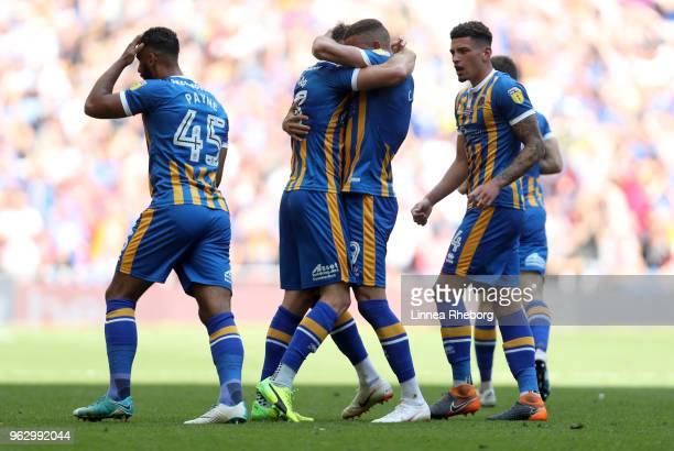 Alex Rodman of Shrewsbury Town celebrates after scoring his sides first goal with team mates during the Sky Bet League One Play Off Final between...