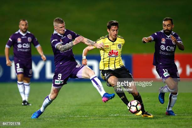 Alex Rodrigeuz of Wellington is tackled by Andrew Keogh of Perth during the round 22 ALeague match between the Wellington Phoenix and the Perth Glory...
