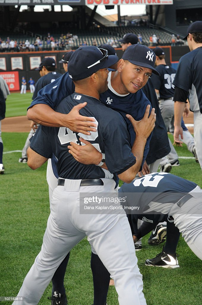 Alex Rodriguez #13 and Mariano Rivera #42 of the New York Yankees chat during batting practice before a MLB game against the New York Mets on May 21, 2010 at Citi Field in the Flushing neighborhood of the Queens borough of New York City.