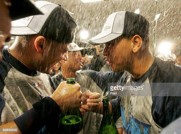 Alex Rodriguez and teammate Derek Jeter celebrate in the locker room after the New York Yankees clinched the AL East division title by defeating the...