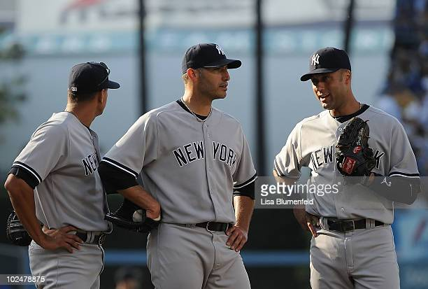Alex Rodriguez Andy Pettitte and Derek Jeter of the New York Yankees meet during the game against the Los Angeles Dodgers at Dodger Stadium on June...