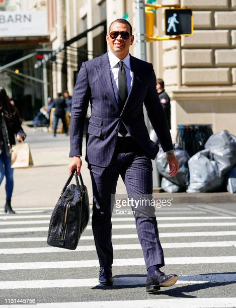 Alex Rodriguez cross the crosswalk wearing his signature pinstripe suit on March 17 2019 in New York City