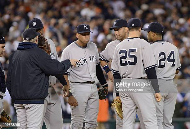 Alex Rodriguez Derek Jeter Mark Teixeira and Robinson Cano of the New York Yankees stand together on the pitchers mound during Game Three of the...