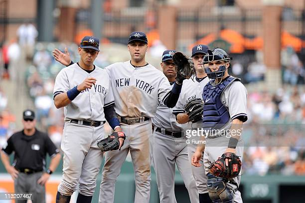 Alex Rodriguez Derek Jeter Robinson Cano David Robertson and Russell Martin of the New York Yankees look towards the dugout during the game against...