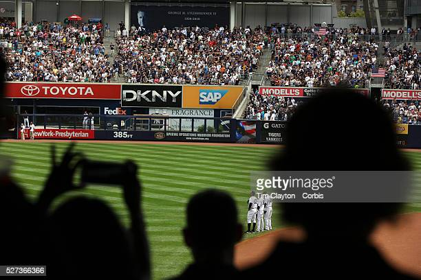 Alex Rodriguez Eduardo Nunez and Robinson Cano during the singing of the National Anthem before the New York Yankees V Detroit Tigers Major League...