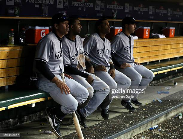 Alex Rodriguez Eduardo Nunez Robinson Cano and Mark Teixeira of the New York Yankees look on from the dugout late in the game against the Detroit...