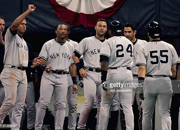 Alex Rodriguez Gary Sheffield and Derek Jeter of the New York Yankees wait to congratulate Ruben Sierra and Hideki Matsui after Sierra hit a game...