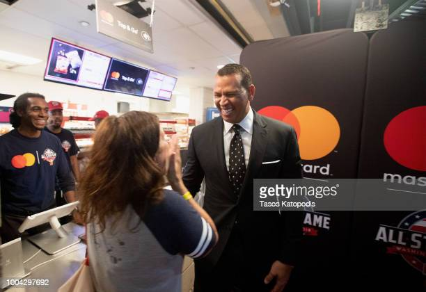 Alex Rodriguez greets a fan before paying for her food with a tap of his Mastercard contactless card at the launch of the Keep Moving Challenge...