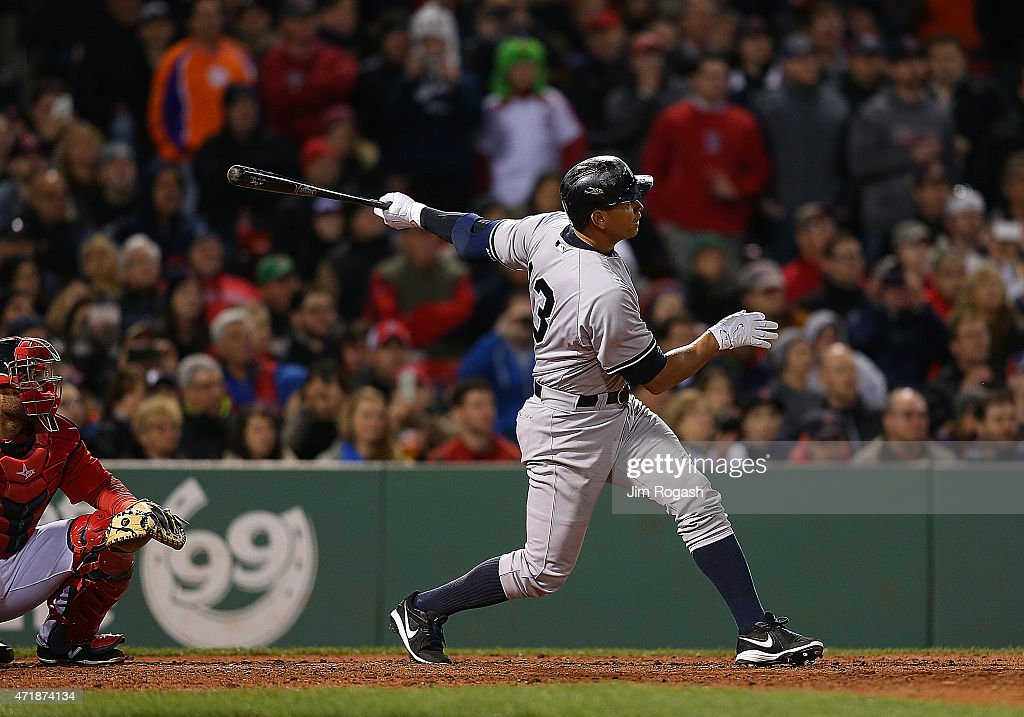 Alex Rodriguez #13 hits 660th career home run to tie Willie Mays record during a game with Boston Red Sox in the 8th inning at Fenway Park May 1, 2015 in Boston, Massachusetts.