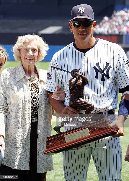 Alex Rodriguez of the New York Yankees accepts the 2007 Babe Ruth Home Run Award from Julia Ruth Stevens daughter of Babe Ruth prior to the game...
