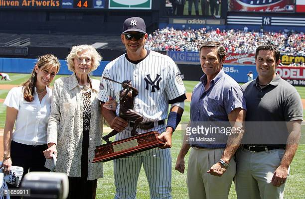 Alex Rodriguez of the New York Yankees accepts the 2007 Babe Ruth Home Run Award from Julia Ruth Stevens daughter of Babe Ruth as grandson Tom...