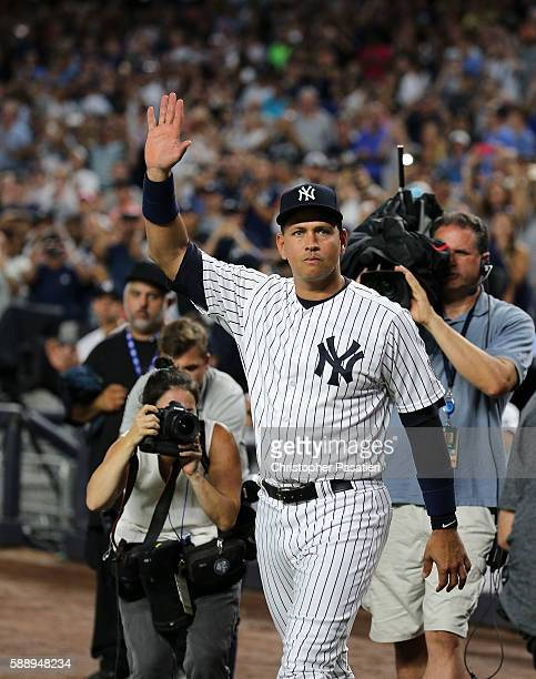 Alex Rodriguez of the New York Yankees acknowledges the crowd after being introduced for a ceremony honoring his retirement from baseball prior to...