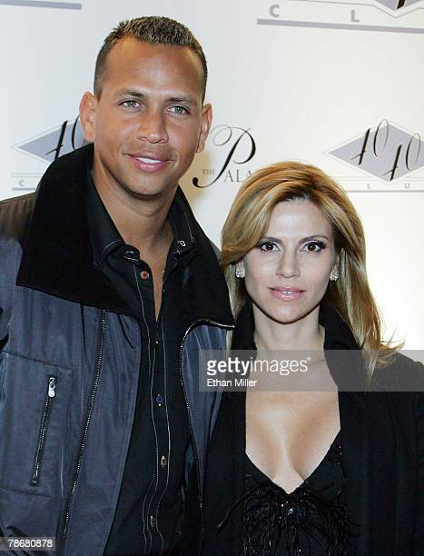 Alex Rodriguez of the New York Yankees and his wife Cynthia Scurtis arrive at the opening of JayZ's USD 20 million 40/40 Club a 24000squarefoot...