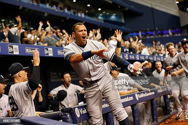Alex Rodriguez of the New York Yankees and manager Joe Girardi celebrate after Slade Heathcott hit a threerun home run off of pitcher Brad Boxberger...