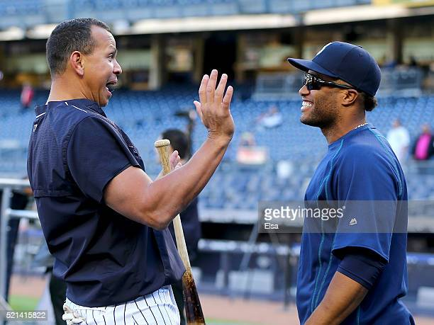 Alex Rodriguez of the New York Yankees and Robinson Cano of the Seattle Mariners talk during batting practice before the game at Yankee Stadium on...