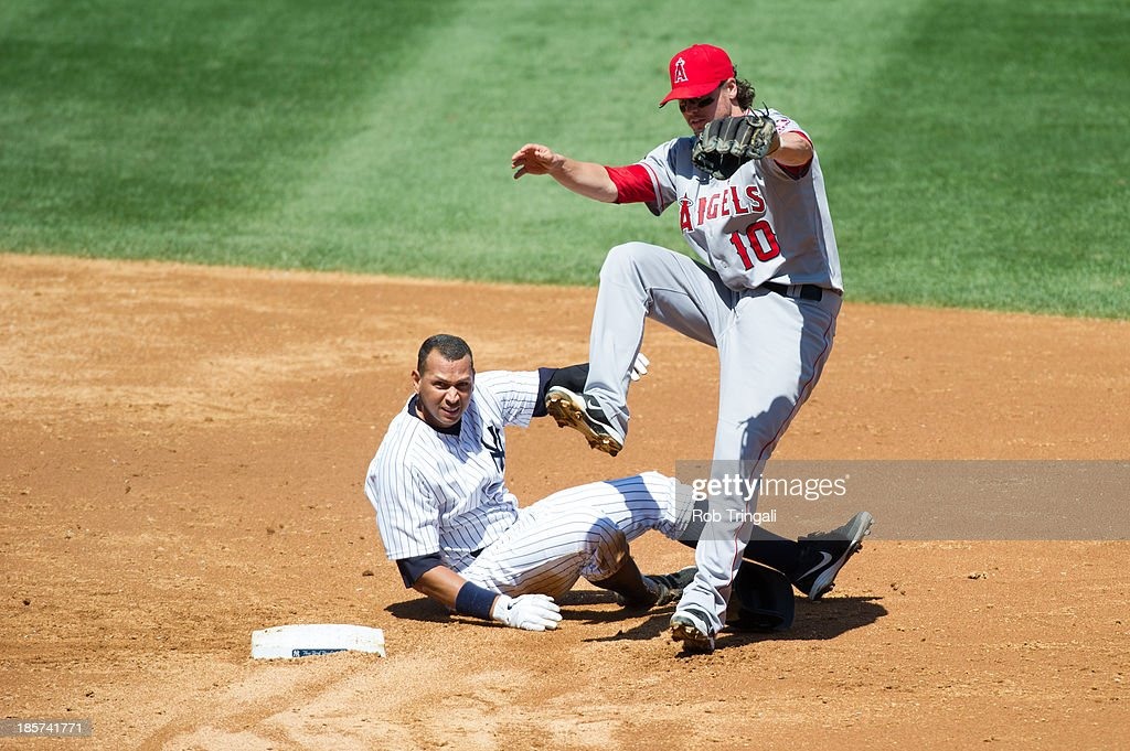 Alex Rodriguez #13 of the New York Yankees attempts to break up the play as he slides into Grant Green #10 of the Los Angeles Angels at second base during the game at Yankee Stadium on August 15, 2013 in the Bronx borough of New York City.