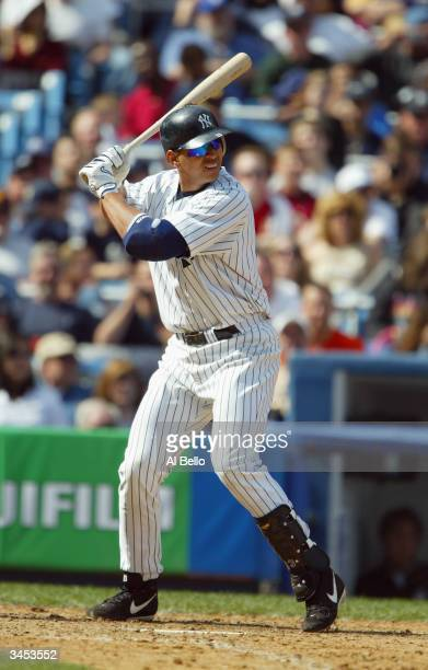 Alex Rodriguez of the New York Yankees bats during the game against the Chicago White Sox on April 10 2004 at Yankee Stadium in the Bronx New York...