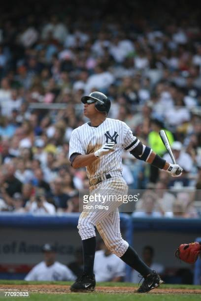 Alex Rodriguez of the New York Yankees bats during the game against the Seattle Mariners at the Yankee Stadium in the Bronx New York on September 3...