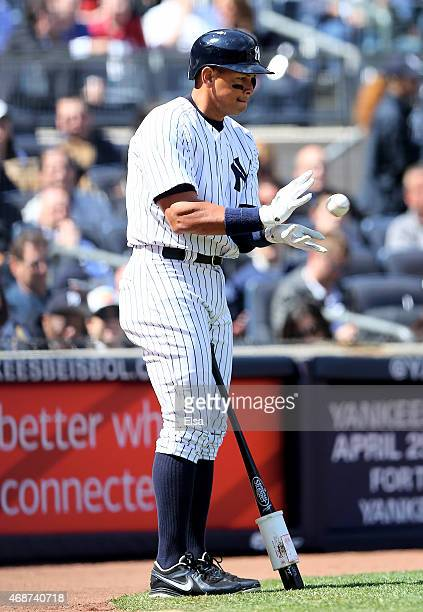 Alex Rodriguez of the New York Yankees catches a foul tip while standing on deck in the second inning as Chase Headley is up to bat against the...
