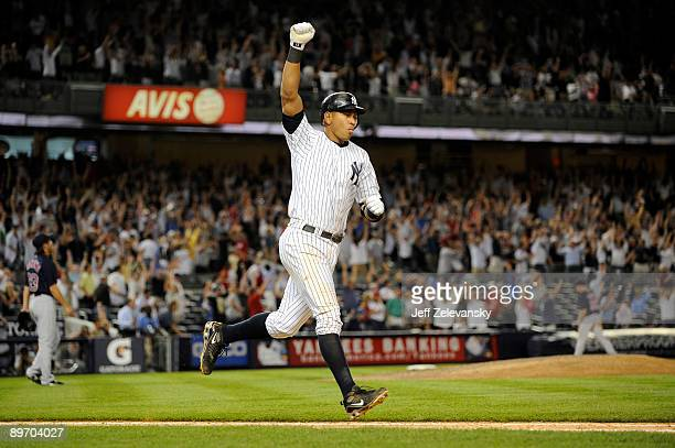 Alex Rodriguez of the New York Yankees celebrates a walk off home run against the Boston Red Sox in the 15th inning on August 7 2009 at Yankee...