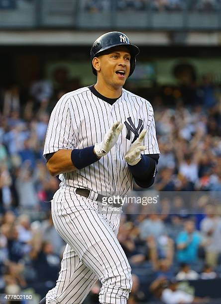 Alex Rodriguez of the New York Yankees celebrates after hitting a home run as well as getting his 3000th career hit in the first inning against...
