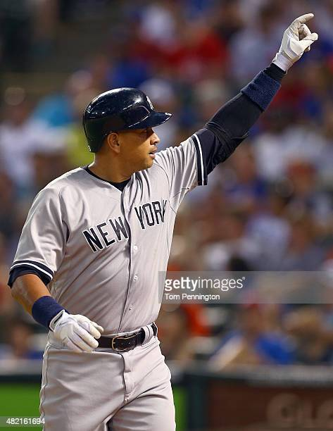 Alex Rodriguez of the New York Yankees celebrates after hitting a solo home run against the Texas Rangers in the top of the sixth inning at Globe...