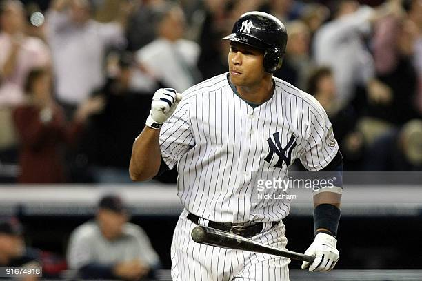 Alex Rodriguez of the New York Yankees celebrates after hitting a two run home run in the ninth inning against the Minnesota Twins in Game Two of the...