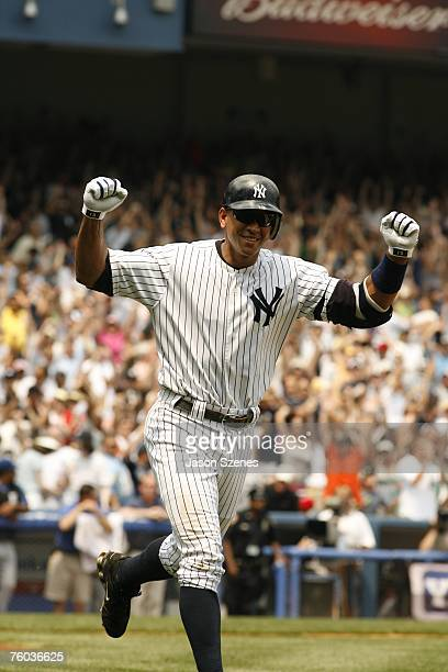 Alex Rodriguez of the New York Yankees celebrates after hitting his career home run number 500 during the game against the Kansas City Royals at the...