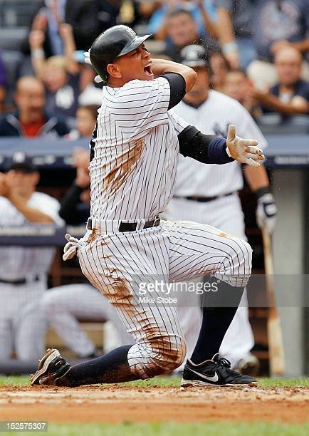 Alex Rodriguez of the New York Yankees celebrates after scoring on Robinson Cano single in the firstinning against the Oakland Athletics at Yankee...
