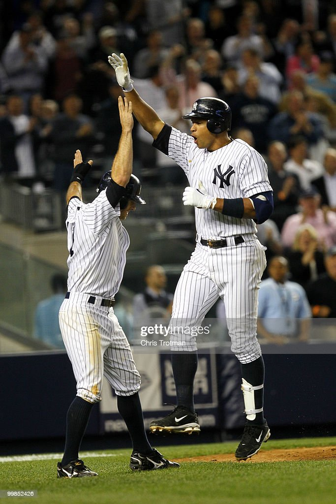 Alex Rodriguez #13 of the New York Yankees celebrates his two-run home run in the ninth inning against the Boston Red Sox on May 17, 2010 at Yankee Stadium in the Bronx borough of New York City. The Yankees defeated the Red Sox 11-9.