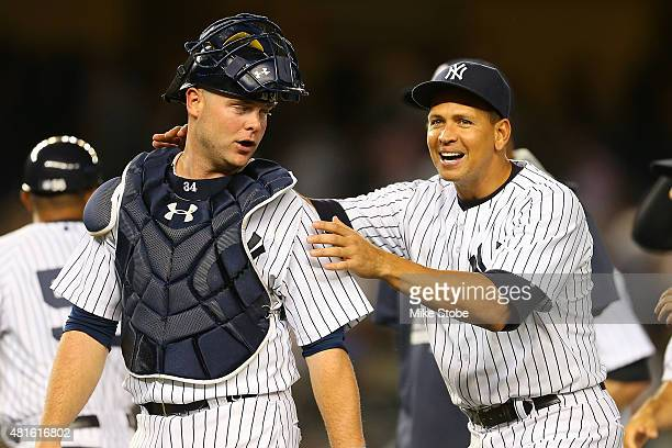Alex Rodriguez of the New York Yankees celebrates with Brian McCann after defeating the Baltimore Orioles at Yankee Stadium on July 22 2015 in the...