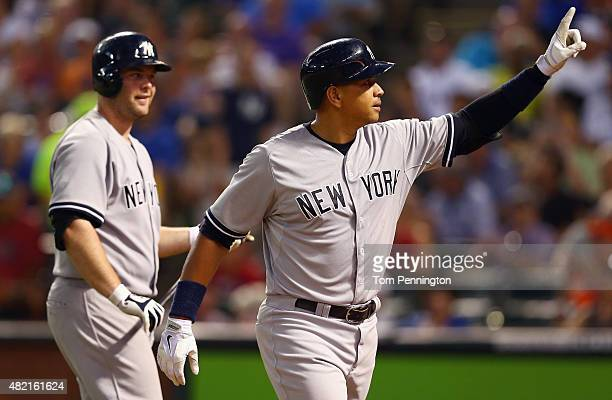 Alex Rodriguez of the New York Yankees celebrates with Brian McCann of the New York Yankees after hitting a solo home run against the Texas Rangers...
