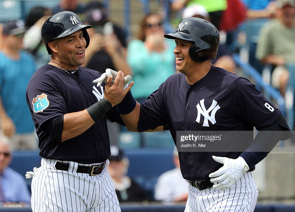 Alex Rodriguez #13 of the New York Yankees celebrates with Carlos Beltran #36 after hitting a two run home run in the first inning during the game against the Philadelphia Phillies at George M. Steinbrenner Field on March 3, 2016 in Clearwater, Florida.