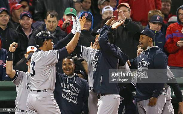 Alex Rodriguez of the New York Yankees celebrates with Joe Girardi of the New York Yankees after hit his 660th career home run to tie Willie Mays...