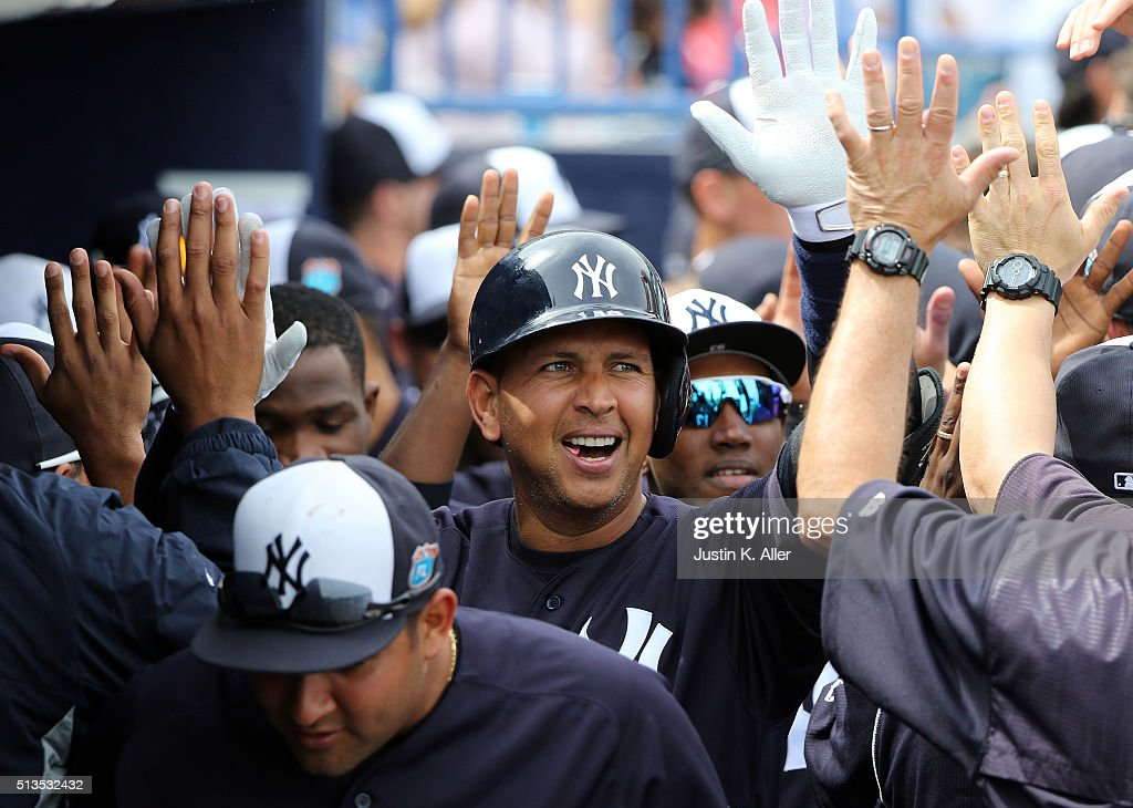 Alex Rodriguez #13 of the New York Yankees celebrates with teammates after hitting a two run home run in the first inning during the game against the Philadelphia Phillies at George M. Steinbrenner Field on March 3, 2016 in Clearwater, Florida.
