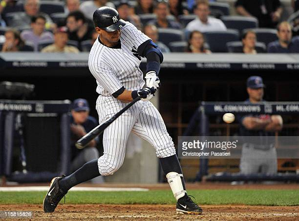 Alex Rodriguez of the New York Yankees connects for a solo home run in the bottom of the fourth inning against the Cleveland Indians on June 10 2011...