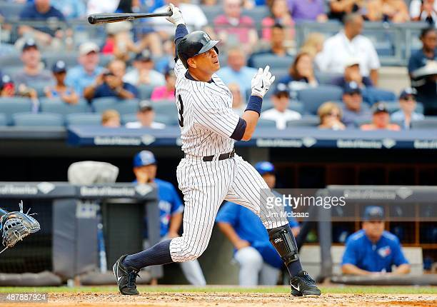Alex Rodriguez of the New York Yankees follows through on a fourth inning two run home run against the Toronto Blue Jays at Yankee Stadium on...