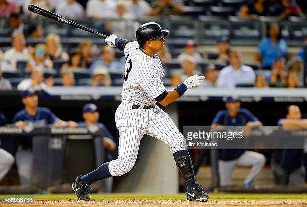 Alex Rodriguez of the New York Yankees follows through on a second inning two run home run against the Tampa Bay Rays at Yankee Stadium on September...