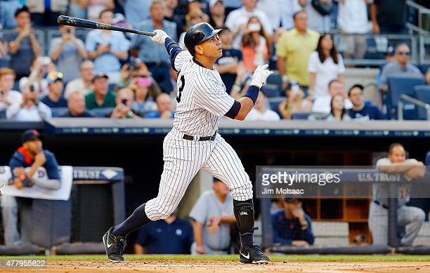 Alex Rodriguez of the New York Yankees follows through on his 3000th career hit a first inning home run against the Detroit Tigers at Yankee Stadium...
