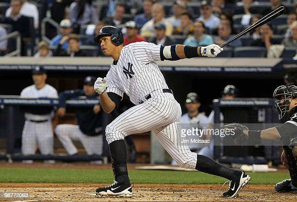 Alex Rodriguez of the New York Yankees follows through on his first inning RBI double against the Chicago White Sox on April 30, 2010 at Yankee...