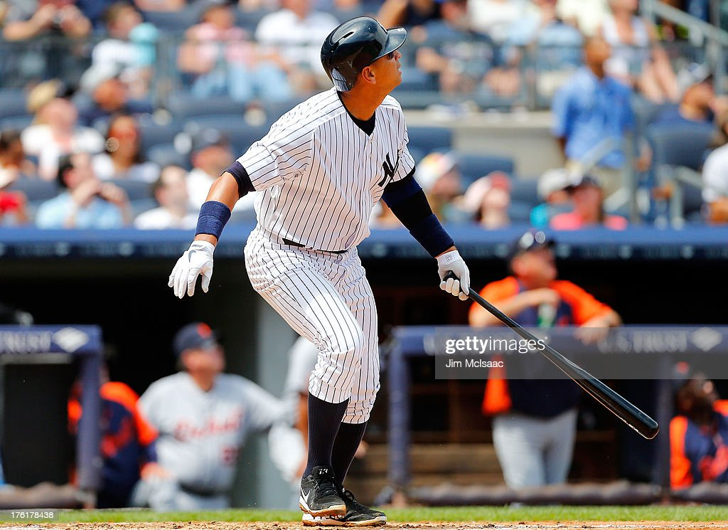Alex Rodriguez #13 of the New York Yankees follows through on his second inning home run against the Detroit Tigers at Yankee Stadium on August 11, 2013 in the Bronx borough of New York City.