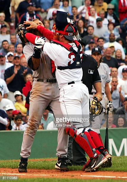 Alex Rodriguez of the New York Yankees gets into a fight with catcher Jason Varitek of the Boston Red Sox after Rodriguez was hit by a pitch by...