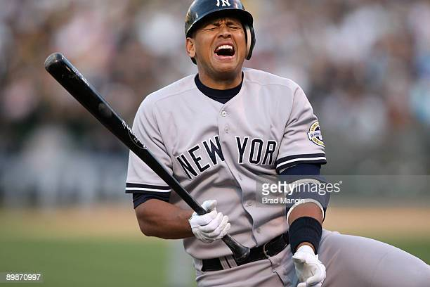 Alex Rodriguez of the New York Yankees grimaces after being hit by a pitch during first inning action against the Oakland Athletics during the game...