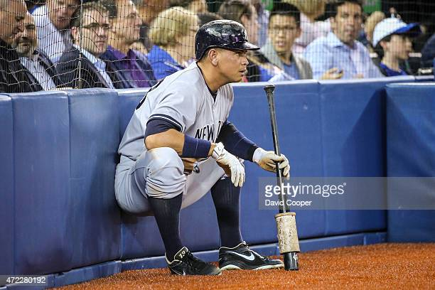 Alex Rodriguez of the New York Yankees has his back against the wall.... Literally as he waits ondeck during the game between the Toronto Blue Jays...