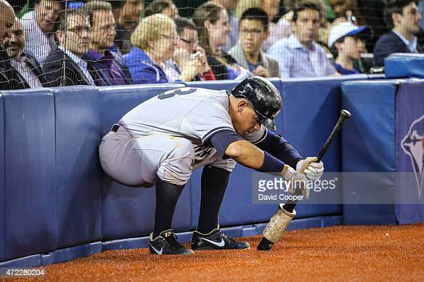 TORONTO ON MAY 5 Alex Rodriguez of the New York Yankees has his back against the wall literally as he waits ondeck during the game between the...